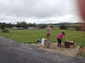 Children playing in sandpit at Raven's Rest Camp site.