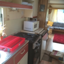 Kitchen area in 3 bed mobile home includes running water and electricity connection